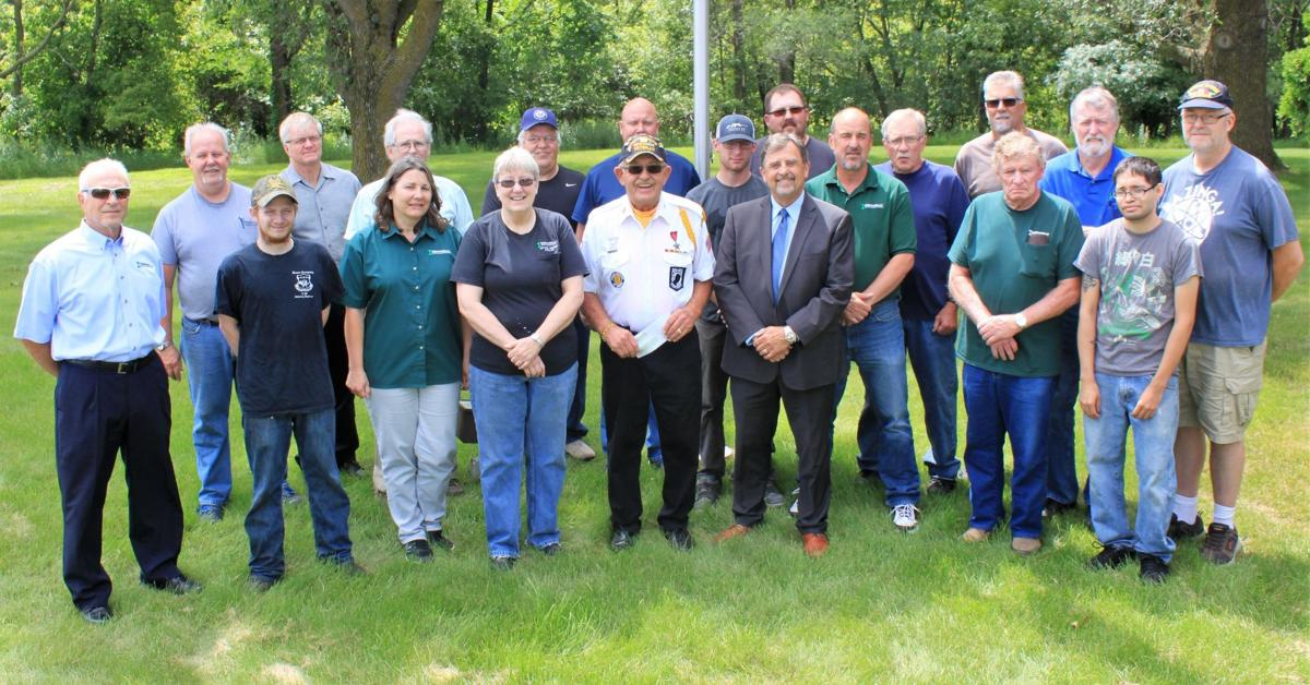 Donnelly employees present check to Veterans Memorial Park