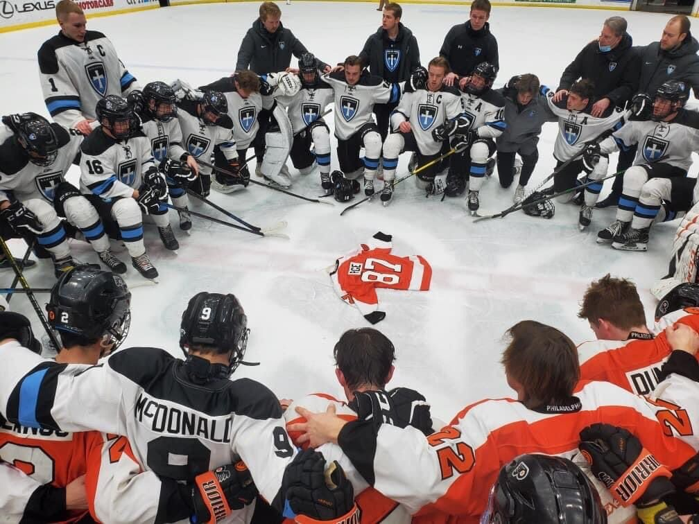 Knights pray with Flyers over