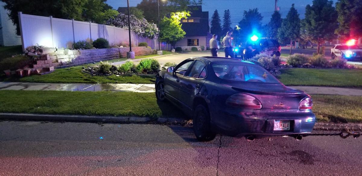 Vehicle crashes into retaining wall