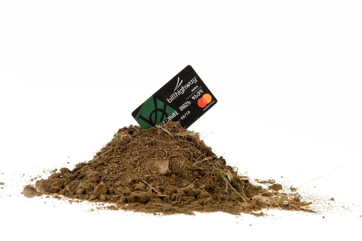 Credit card in dirt