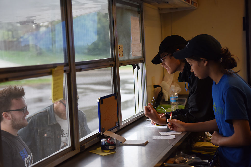 Yada Olson, right, and Levi Olson, Yada's brother, take orders