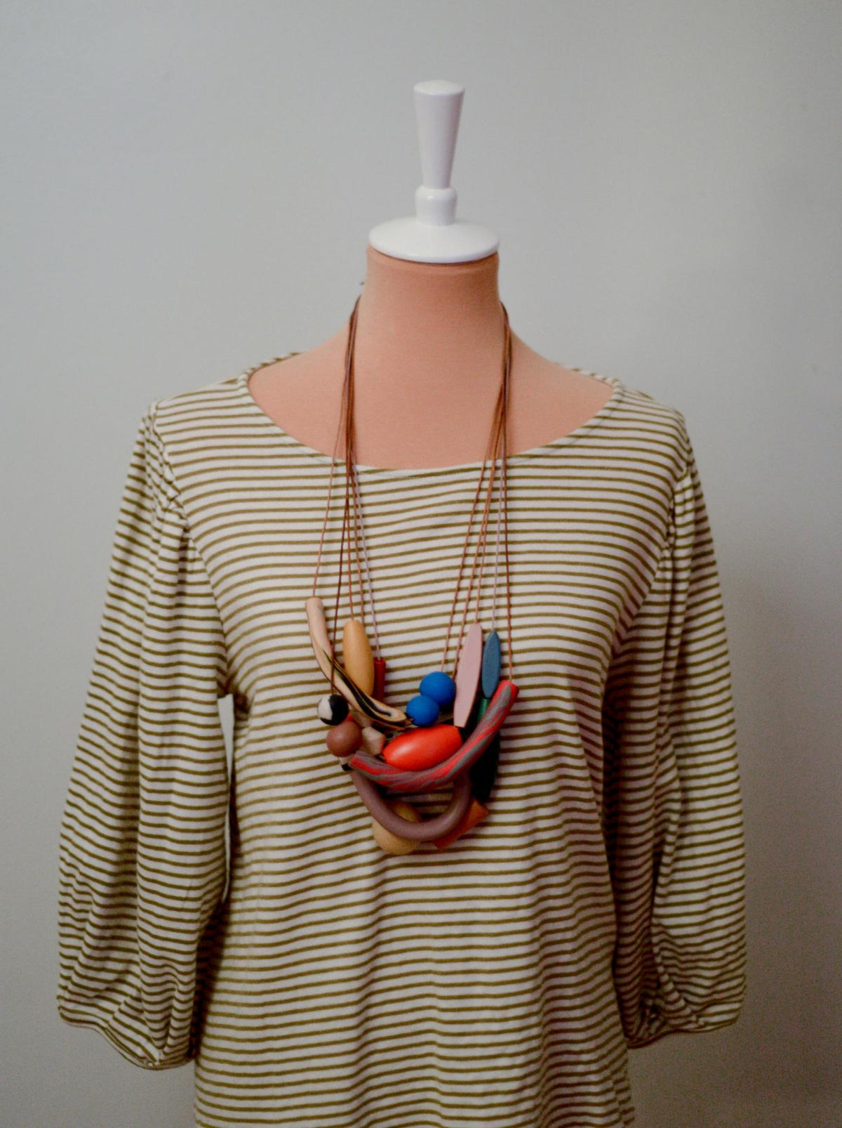 Samae Claspill's necklace hangs on a mannequin