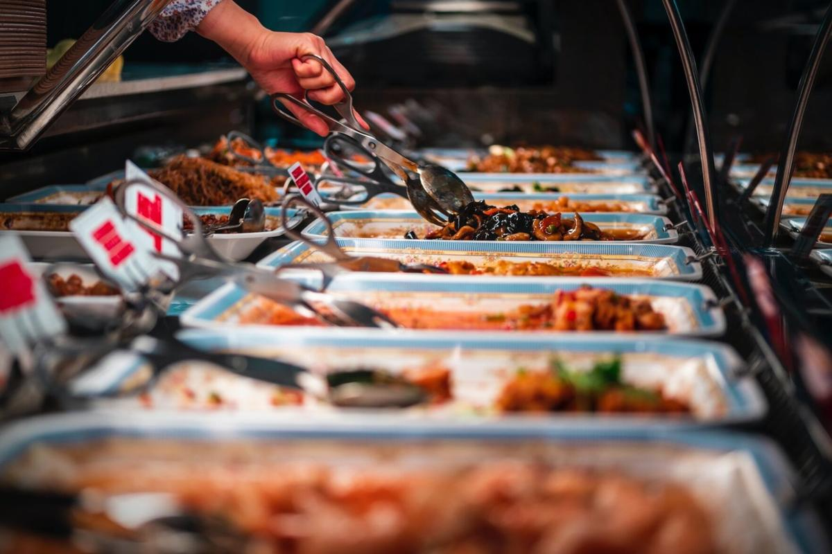 Hand self-serving buffet style food