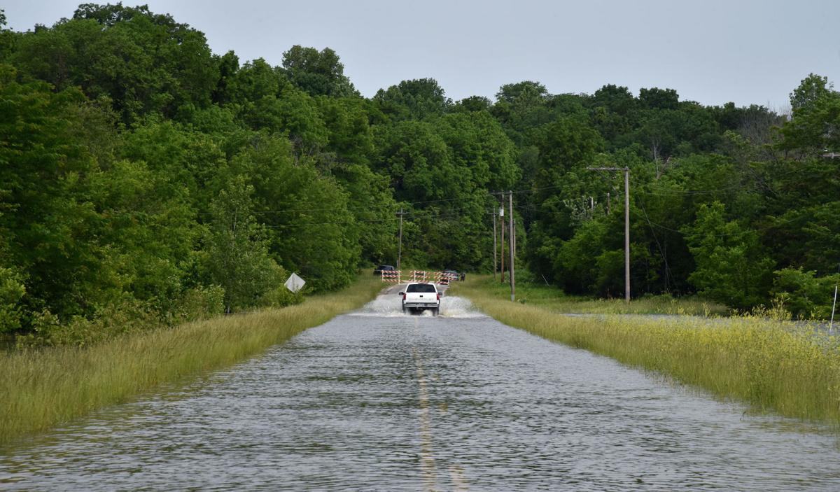 """A driver ignores """"Road Closed"""" signs in Rocheport and drives along Highway 240"""