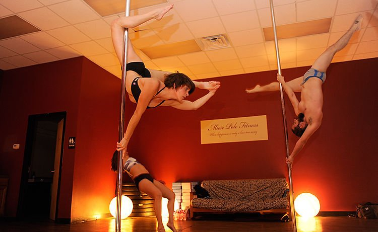 Dancers practicing at Muse Pole Fitness