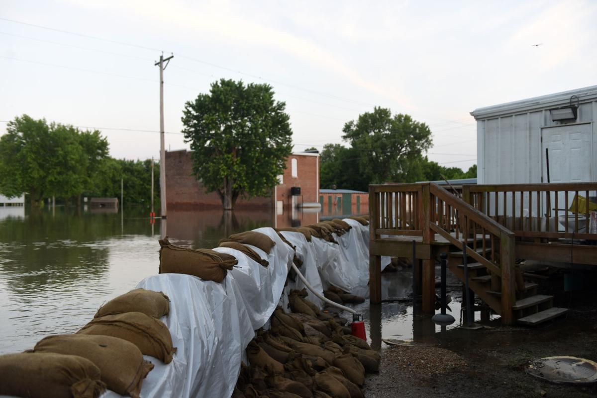 Concrete walls with sandbags on both sides were built to protect Mokane from flood waters