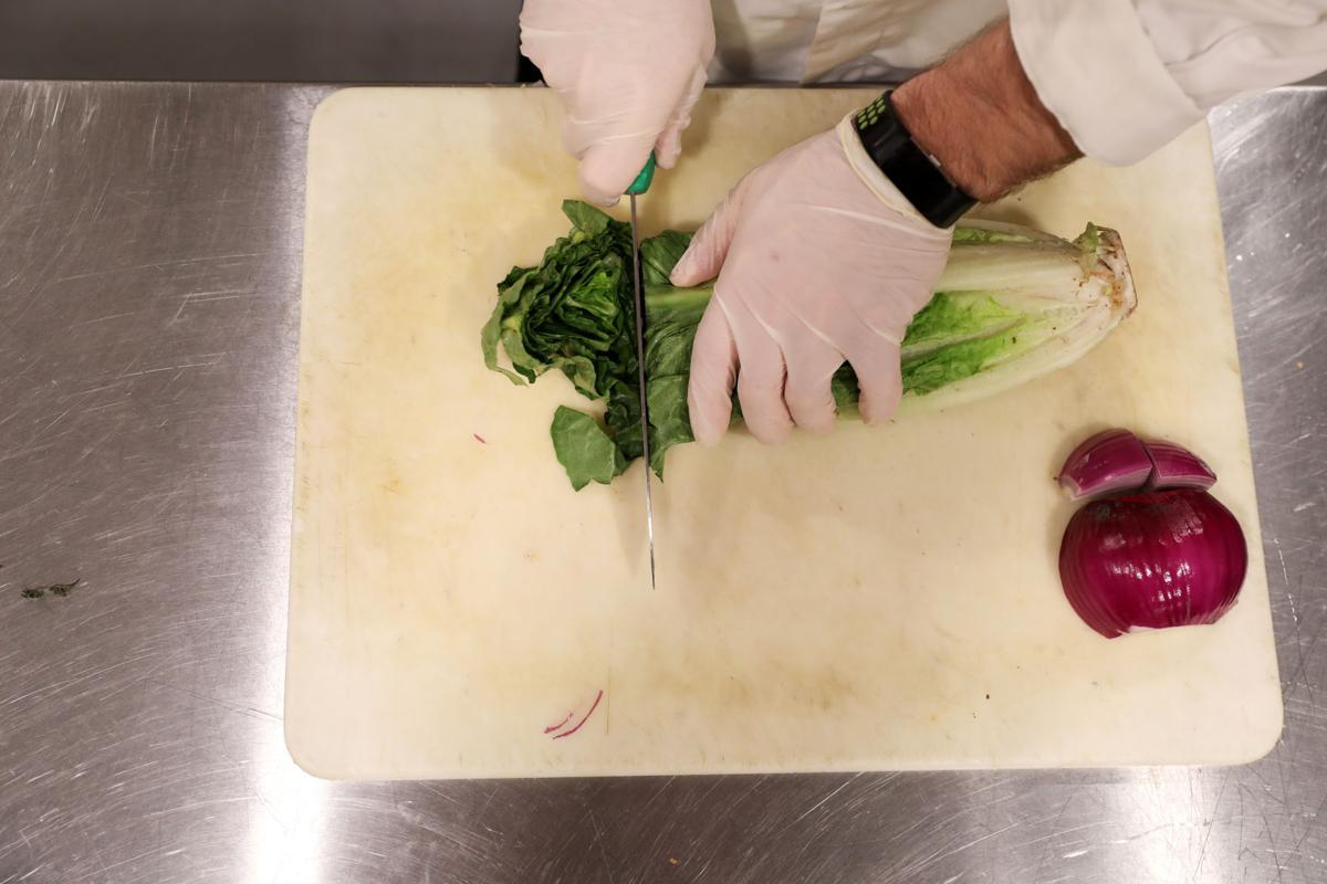 Chris Lammers prepares lettuce for lunch