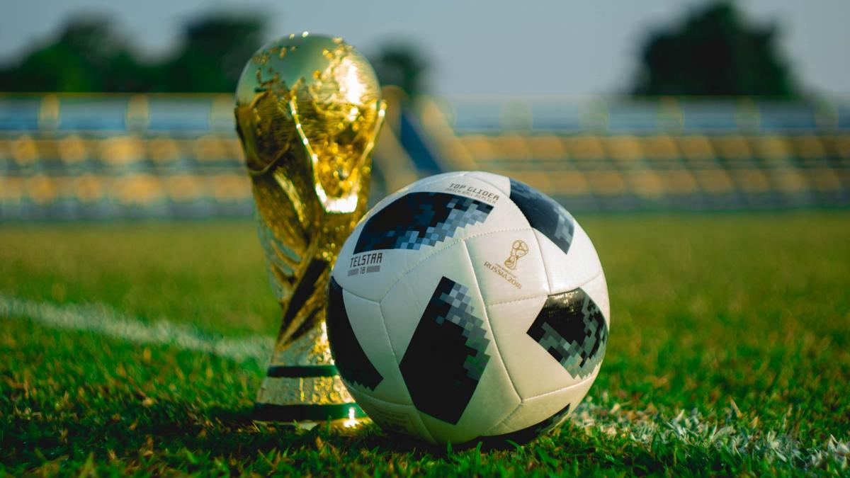 Soccer ball and world cup trophy