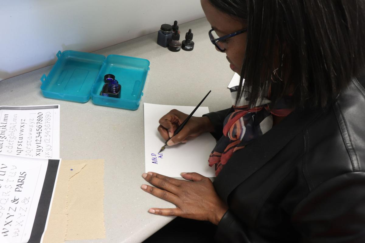 Lisa Lenoir hand-letters in her office.