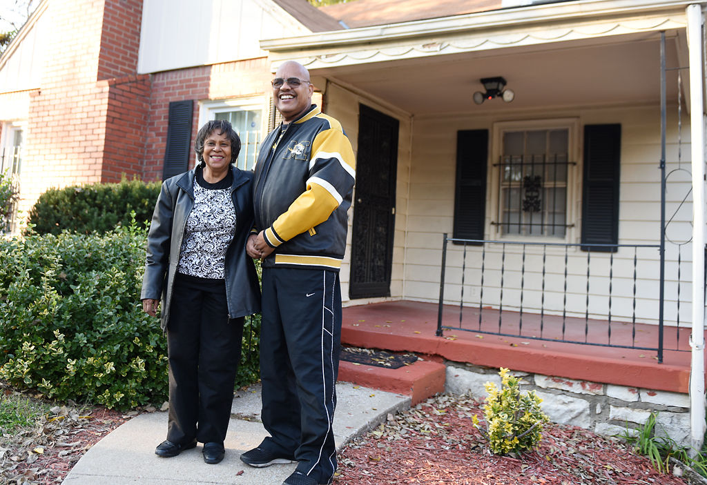 Jim and Janice Nunnelly stand in front of their house