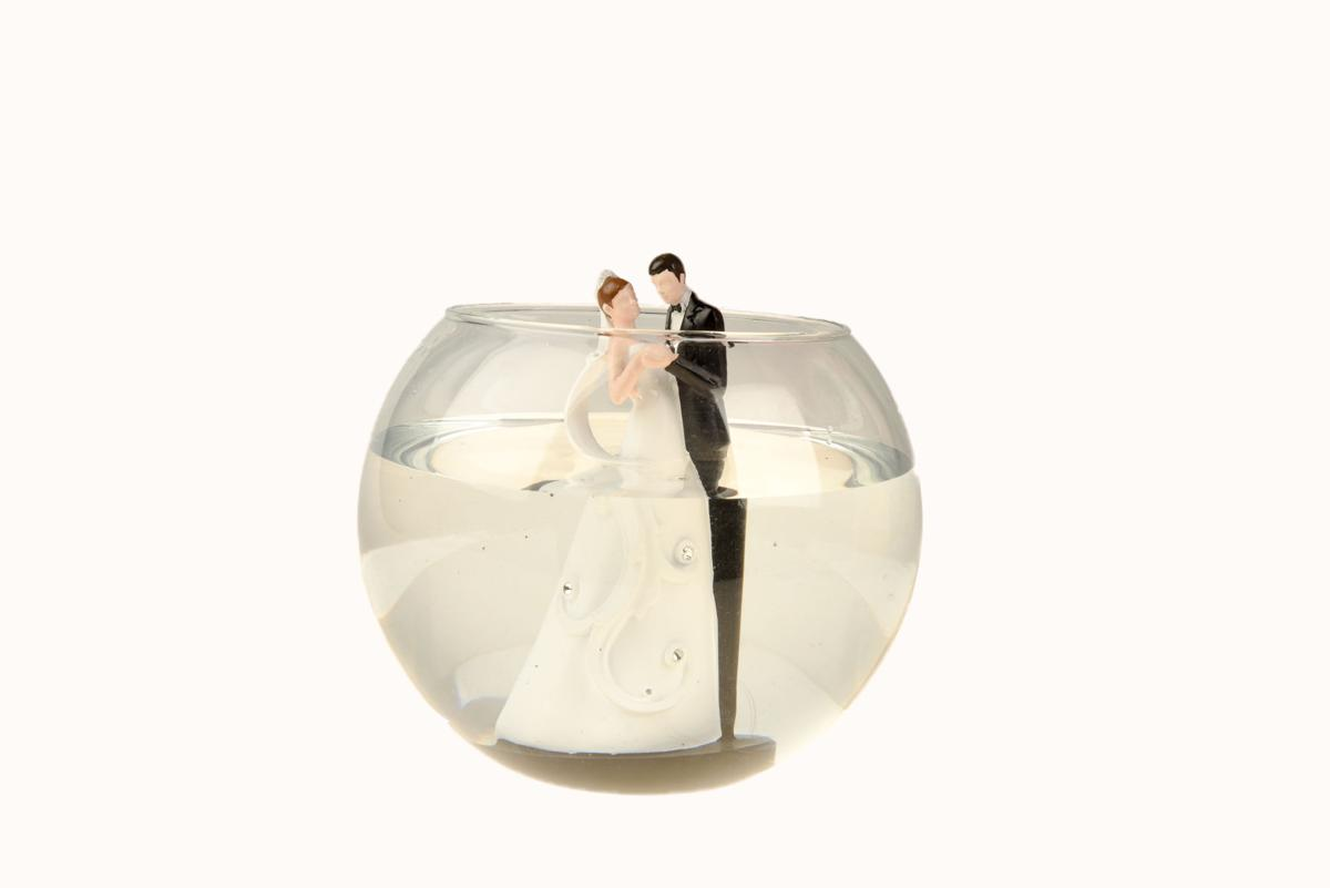 Bride and groom in fishbowl