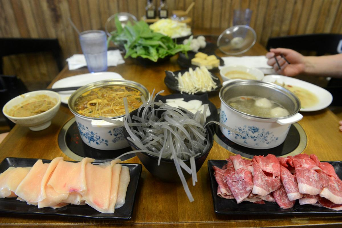 Customers eat hot pot at Taste Place