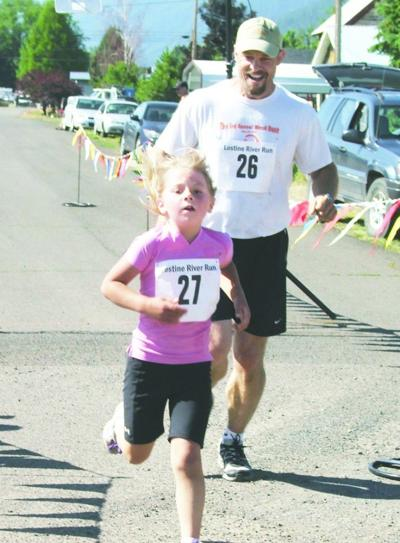 Families part of hot Lostine River Run