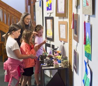 Choosing favorite at Youth Art Show.