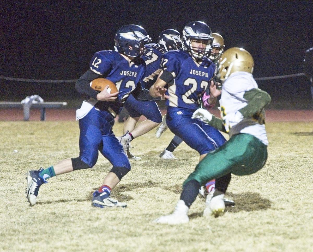 Joseph 4P Carson Littlepage runs the ball while Trace Collier thorws a block..jpg