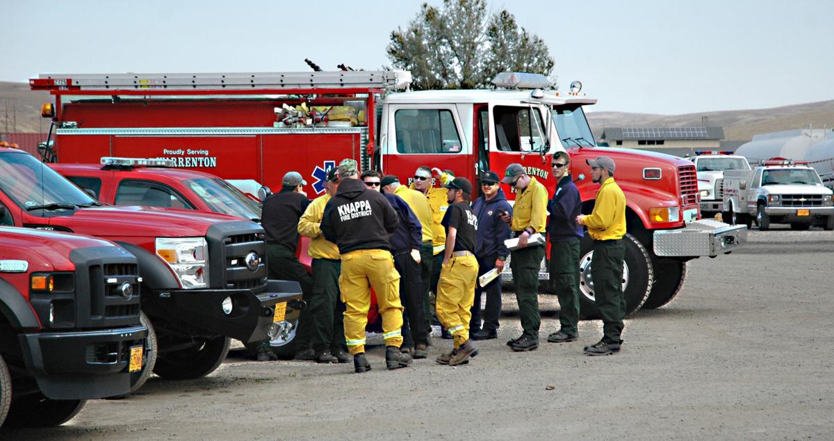 """Fire swells as """"Green Team"""" arrives"""