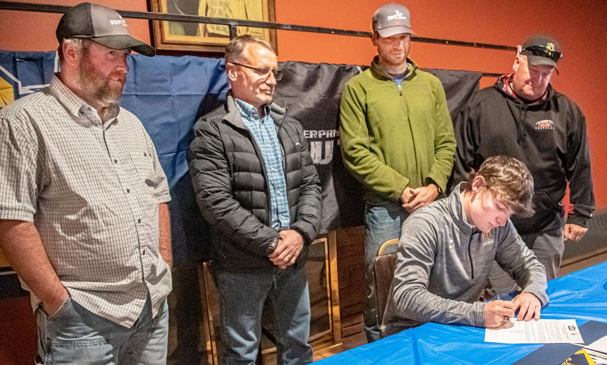 1 Trace  Evans  signs all coaches Print.jpg
