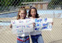 Girls picket for Enterprise swimming pool