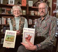 Skovlins sign 'outlaw' books during visit to home
