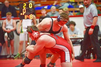 Jonah Staigle wins at 220 lbs