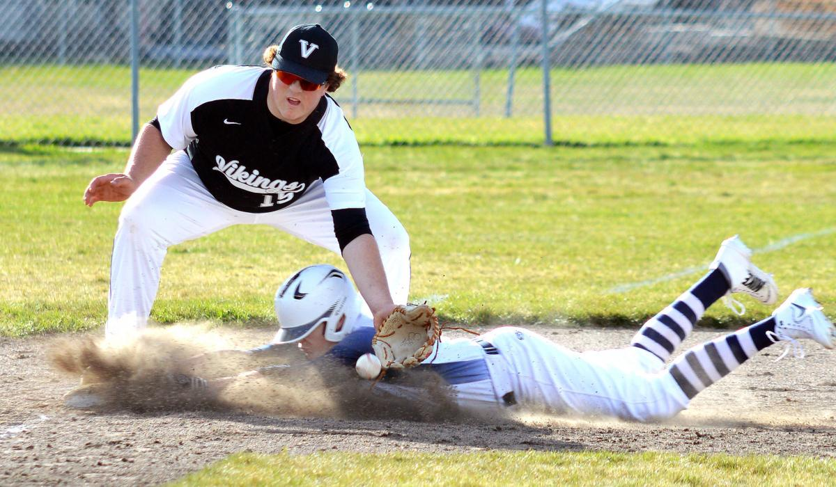 Baseball team goes 1-1 in league opening double-header