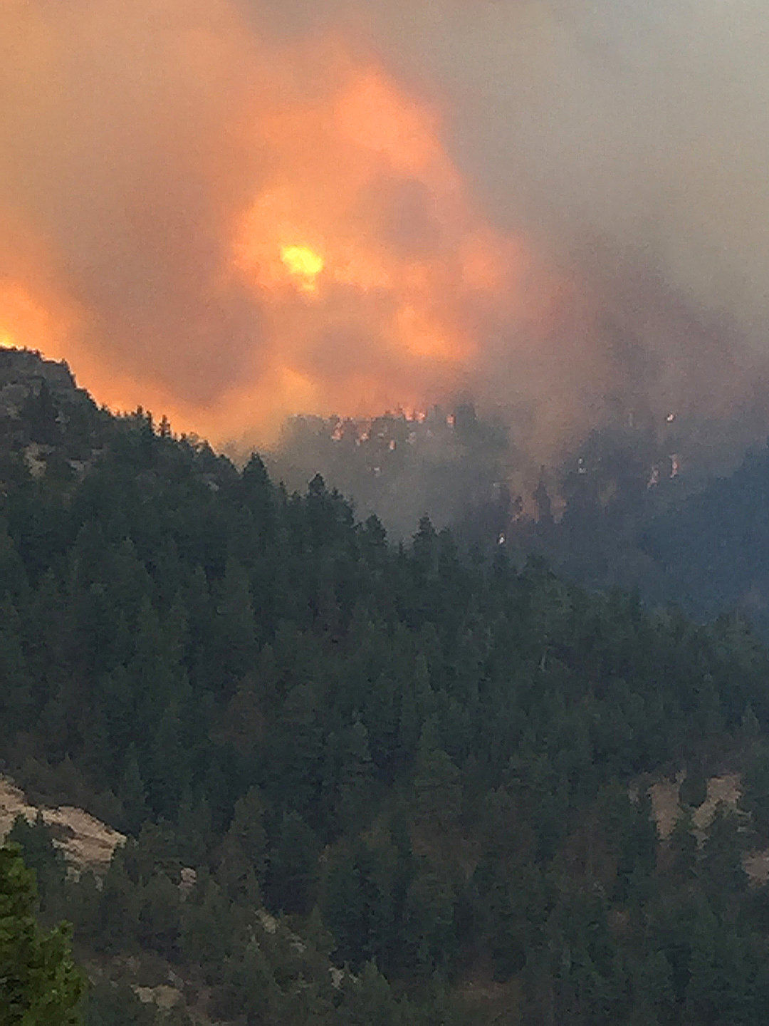Friends, family keep anxious eyes on wildfires