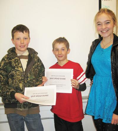 EHS students teach fifth graders about finance