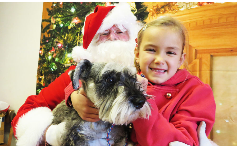 Santa Paws greets kids, pets from all over