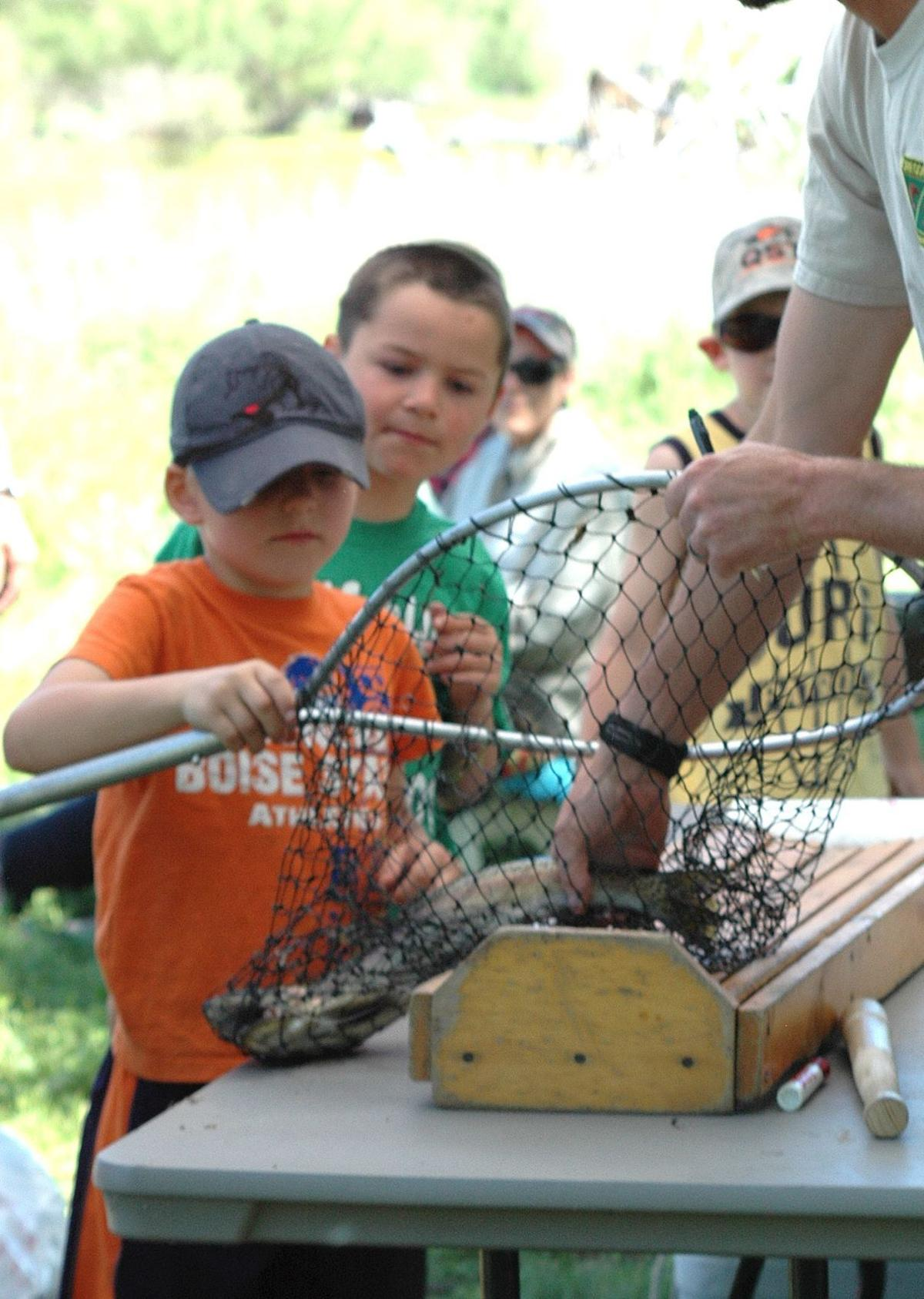 Littlest fisher takes home biggest fish