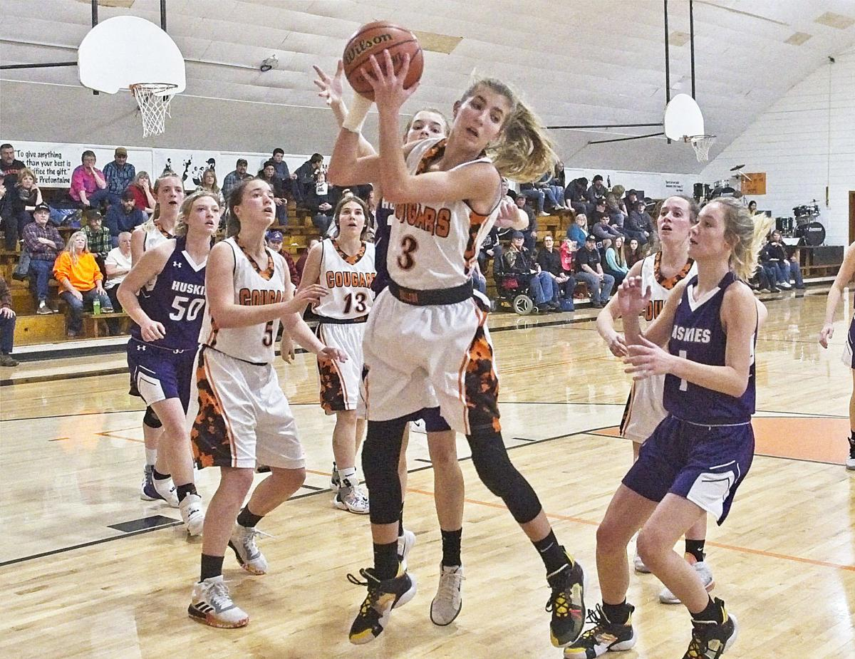 Wallowa Elgin girls 31 jan  Wallowa's Bailey Hafer grabs a rebound.jpg