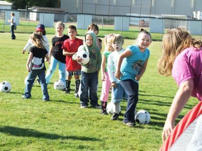 Having a ball at Saturday Soccer Clinic
