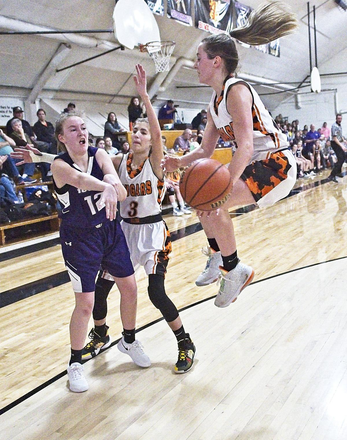 Wallowa Elgin girls 31 jan  Wallowa's Kyla Hook leaps to deflect Elgin's Mariah Wilhelm's pass whiile Bailey Hafer cuts off the escape route.jpg