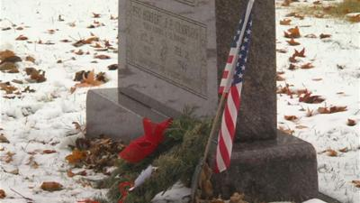 Students place wreaths on vets' graves
