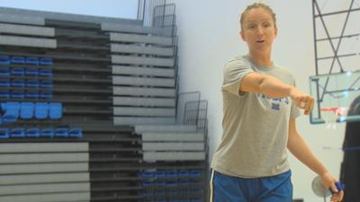 Olivia Lett  coaches Millikin basketball campers