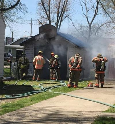 Brush fire pushed to garage; contents destroyed