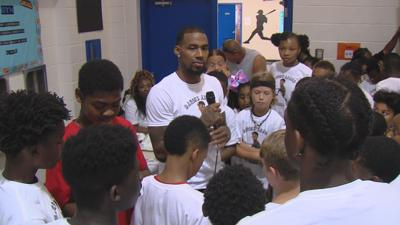 Darius Adams hosts a kids camp at the Boys & Girls Club of Decatur