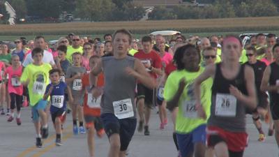 Hundreds run to honor officer