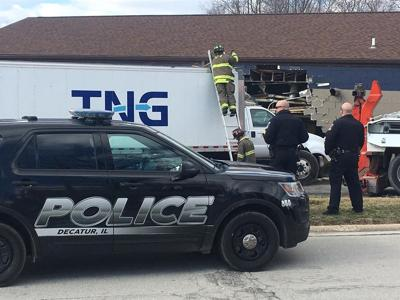 Truck crashes into dry cleaning business