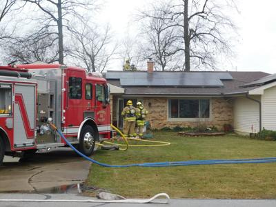 Firefighters enter home