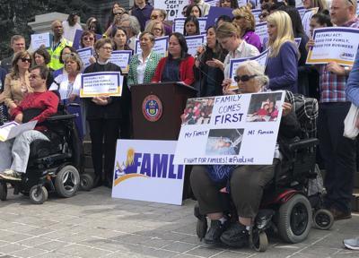 FILE- Colorado Paid Family Leave