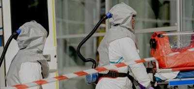 Hazardous material medical team entering building