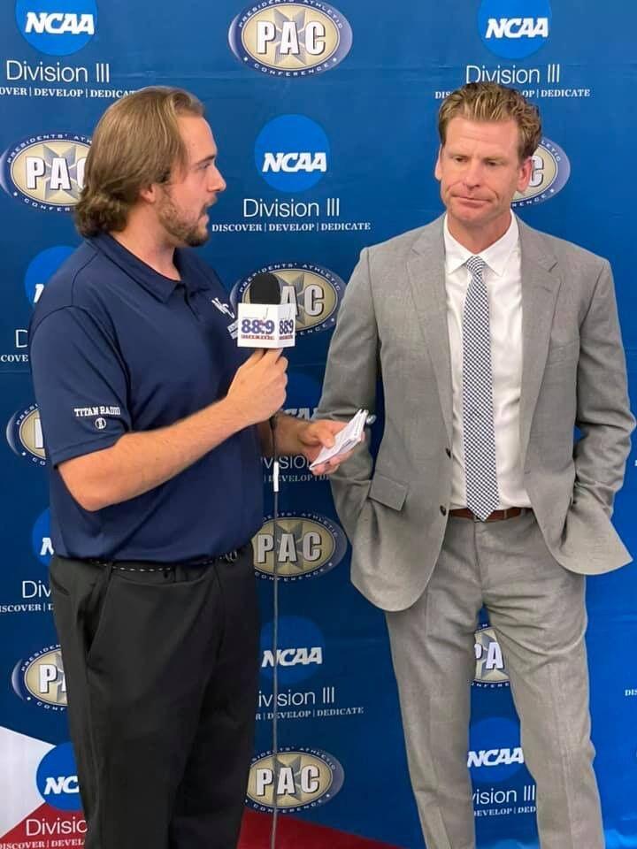WCN & Titan Radio Sports Announcer Mason Flannigan and Head Coach Scott Benzel.