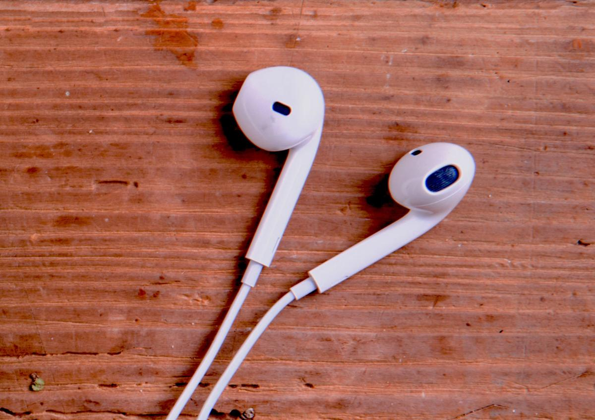 ear buds on wooden table