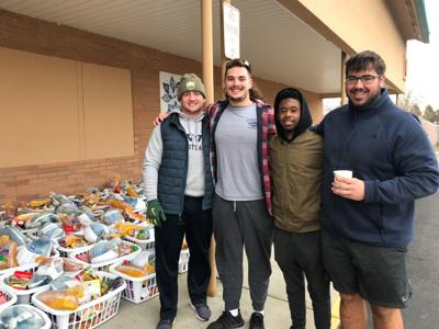 Football players (from left, seniors Brady Hogue, Aaron Pierce, Chase Collison and junior Cameron Mika) take a break from volunteering at the Children's Advocacy Center.