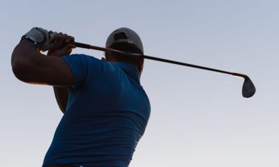 golfer hitting long shot- men's golf