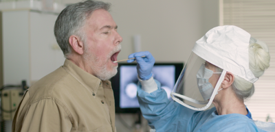COVID-19 test-coronavirus test- man getting swabbed for covid-19 test