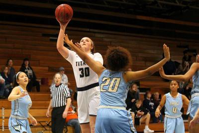 Women's Basketball: Late Rally Propels Titans Past Presidents