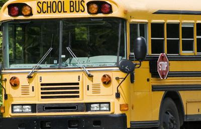 School Bus Traveling On Interstate in Springtime
