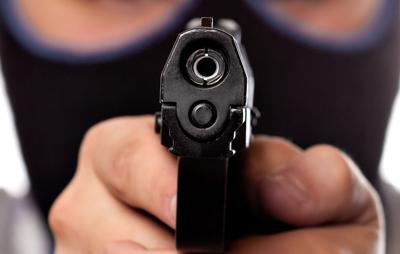 Ski Masked Criminal Pointing a Gun