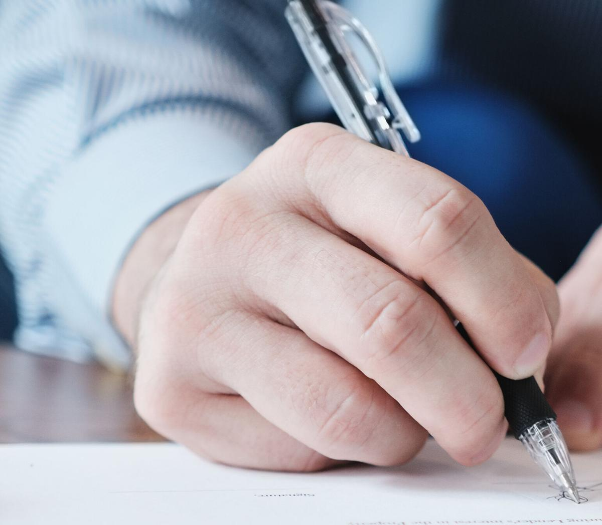 Closeup of Manager Signing Contract In Business Office
